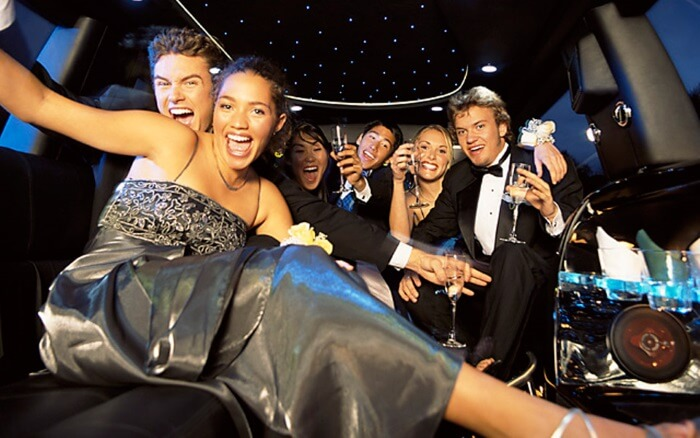 happy young people in a party bus