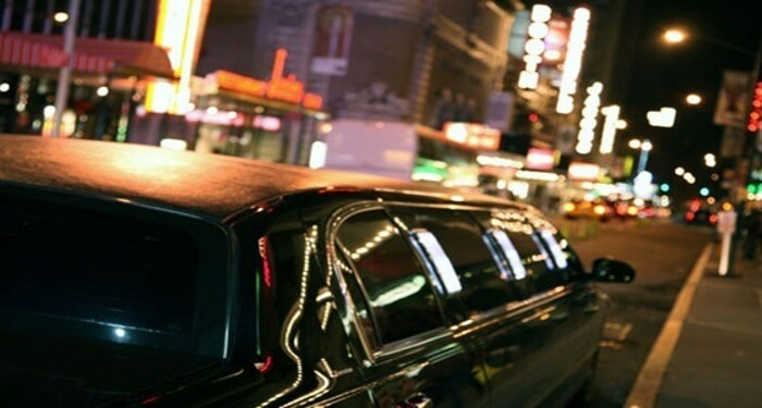 limo driving through the city night