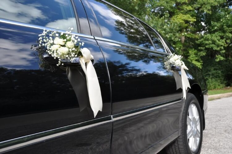 wedding limo door close up with flowers